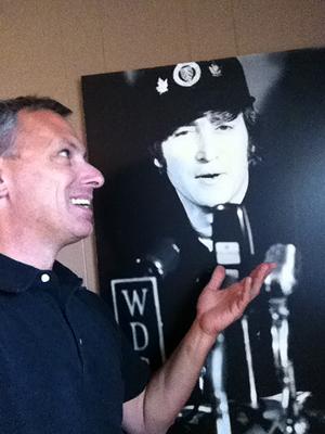 Paul 'Pash' Pashibin with a rare John Lennon poster. Image courtesy of Paul Pashibin.