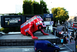 Czech sculptor David Cerny's 'London Booster,' a classic Routemaster London bus fitted with hydraulic 'press-up' arms, made to market the Czech participation in the London 2012 Olympics. Image courtesy the Czech Embassy, London.