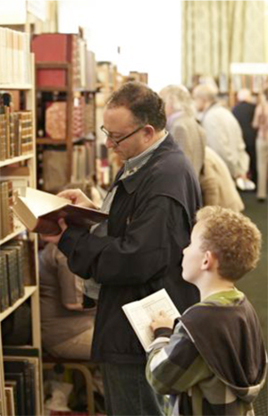 Customers at a Chelsea Antiquarian Book Fair. Chelsea Antiquarian Book Fair image.
