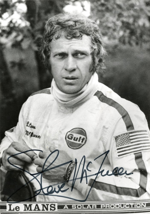 Signed Steve McQueen publicity photo from the 1971 film 'Le Mans.' Sold for $3,690 inclusive of 23% buyer's premium. Image courtesy of LiveAuctioneers.com and Profiles in History.