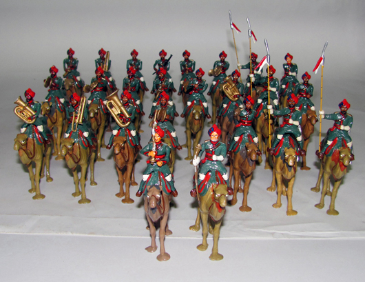 Walt Dineen 35-piece postwar Indian Camel Corps, $660. Old Toy Soldier Auctions image.