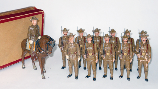 Pfeiffer composition U.S. mounted officer and infantrymen, 90mm, original box, $4,920. Old Toy Soldier Auctions image.