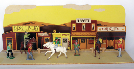 Johillco for British Mid West Importers 18-inch-wide Cowboy Town façade and baseboard with cowboy and cowgirl figures, $4,080. Old Toy Soldier Auctions image.