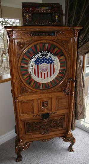 Antique Dewey upright slot machine, est. $52,500-$105,000. Government Auctions image.