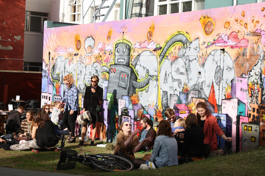 The city's young crowd gathers at the small park to make the most of the summer sun. I wonder what the park looks like in the winter when the city gets about four hours of sunlight a day. Street art by unknown artist, Reykjavik, Iceland. Photo by Kelsey Savage.