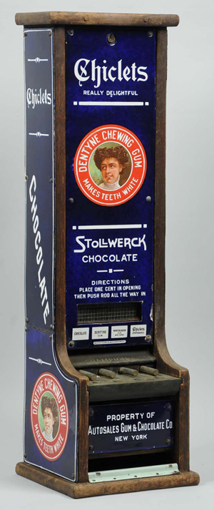 Stollwerck and Chiclets vending machine designed to dispense both chocolate candy and chewing gum; porcelain with wood back, $28,200. Morphy Auctions image.