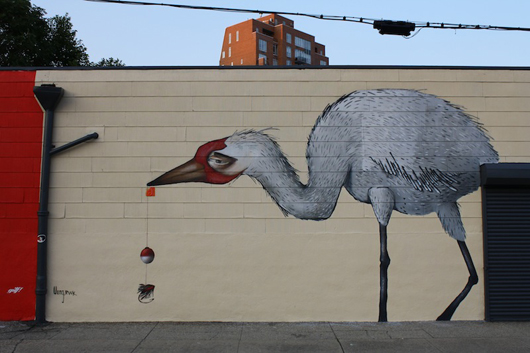 The masterful stork with a mischievous eye and a fishing lure tucked in his bill is by H. Veng Smith, one of the members of street artist-collaborators Robots Will Kill. His oil painting clearly translates to his graffiti with its incredibly rich details. Mural by Veng, Williamsburg. Photo by Kelsey Savage.