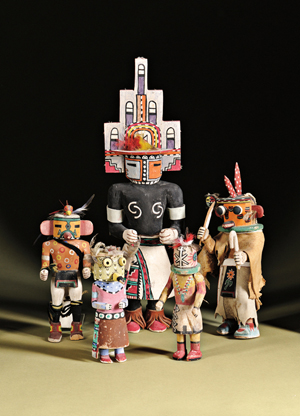 The largest kachina in this group is lot no. 153, a Hopi carved wood hemis kachina by White Bear Fredericks, 19 1/2 inches. Estimate: $500-$700. Skinner Inc. image.
