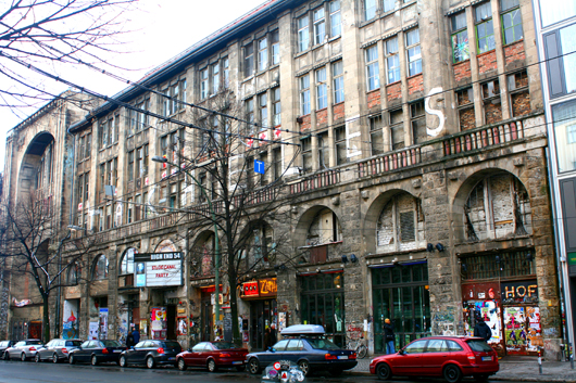 The Kunsthaus Tacheles building housed an art center in Berlin. Huge, colorful graffiti-style murals are painted on the exterior walls, and contemporary art sculptures are featured inside. This file is licensed under the Creative Commons Attribution-Share Alike 3.0 Unported license.