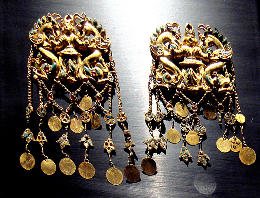 Included in the Bactrian Treasure are earrings from the royal burial Tillia tepe, first century B.C. in Bactria. Image by Musee Guimet. This file is licensed under the Creative Commons Attribution-Share Alike 3.0 Unported license.