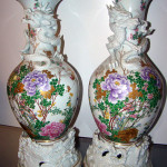 Pair of 36-inch Chinese vases wrapped with three-dimensional dragons. TAC Auctions image.