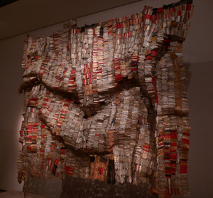 v'Man's Cloth' by El Anatsui, 1998-2001, which is a modern interpretation of kente cloth from the artist's native Ghana. On display at the British Museum, the work is made up of hundreds of metal bottleneck wrappers, stitched together with copper wire. This file is licensed under the Creative Commons Attribution-Share Alike 3.0 Unported license.