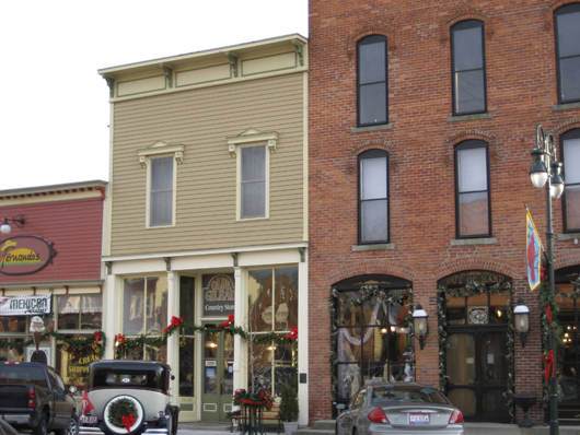 Storefronts overlooking the Maumee River in Grand Rapids, Ohio. Image by J.D. Zollars. This work is licensed under the Creative Commons Attribution-ShareAlike 3.0 license.