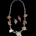 Leekya Deyuse Zuni fetish necklace and earrings. Estimate: $3,000-$5,000. Cowan's Auctions Inc. image.
