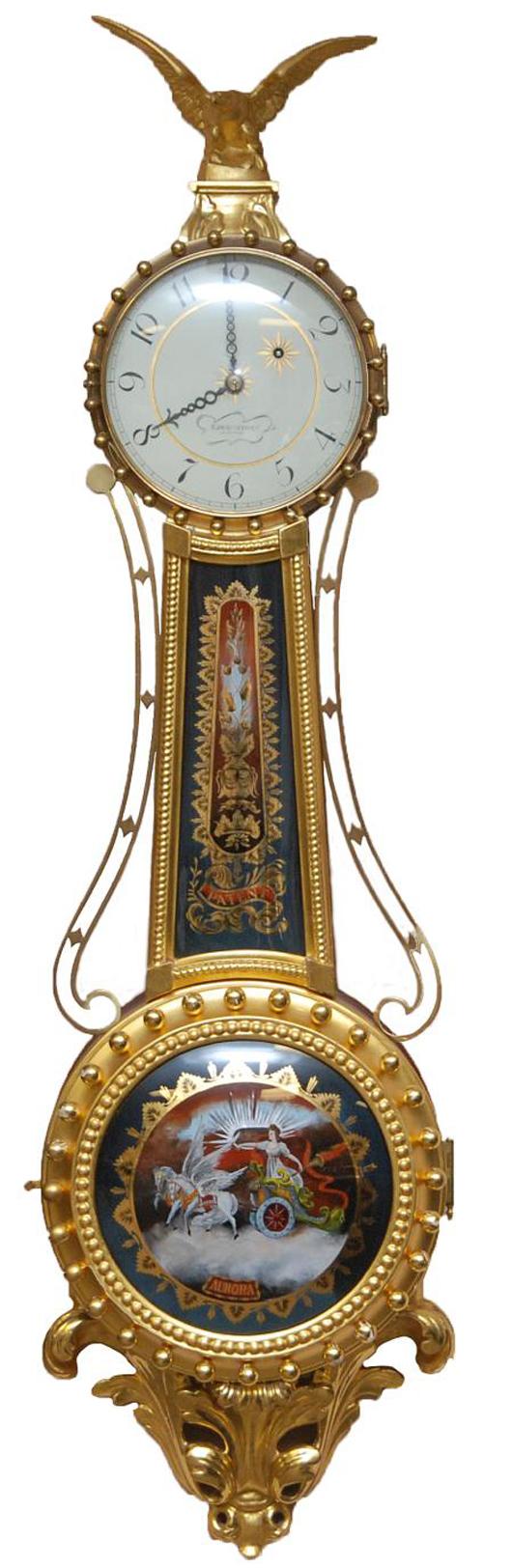 Striking 20th century Elmer O. Stennes 'Aurora' girandole banjo clock. Estimate: $3,000-$5,000. Elite Decorative Arts image.