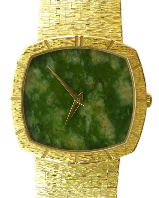 Stunning gentleman's 18kt yellow gold Piaget watch with jadeite face design. Estimate: $6,000-$8,000). Elite Decorative Arts image.