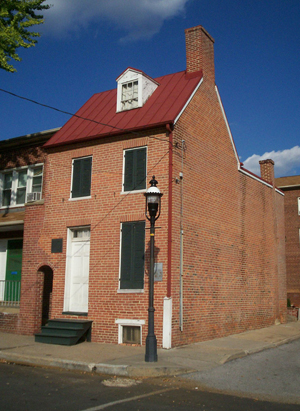 Exterior of the Edgar Allan Poe House and Museum, a National Historic Landmark located at 203 N. Amity St. in Baltimore, Maryland. Poe resided there in the 1830s. Displays in the museum include a lock of Poe's hair.