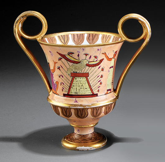 An elaborate Egyptian offering scene circles a two-handled Coalport vase, circa 1810, recently sold for $1,037. Courtesy Neal Auction Co.