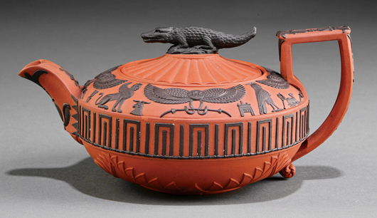 Wedgwood applied Egyptian designs in relief to their dry rosso antico body. This early 19th century red and black teapot – complete with crocodile finial – sold for $2,151. Courtesy Neal Auction Co.