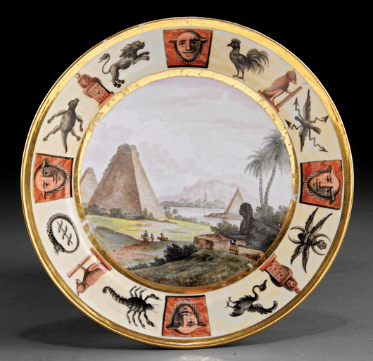 Responding to the passion for all things Egyptian, Paris porcelain decorators painted cabinet plates with scenes of the Nile. This example from the Lee Anderson Collection brought $2,868. Courtesy Neal Auction Co.