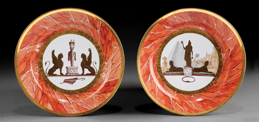 A pair of decorated cabinet plates with a russet marble border, marked by Paris porcelain makers Locre, Russinger, Pouyat, realized $5,079 at auction in September. The plate on the right features the Egyptian goddess Isis on a pedestal between two sphinxes. Courtesy Neal Auction Co.