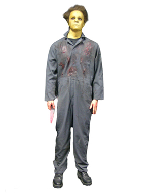 Full figure of Michael Myers, the diabolical killer of the Halloween franchise, dressed in the mask and coveralls worn by actor Chris Durand as Myers in Halloween H2O (1998). Premiere Props image.