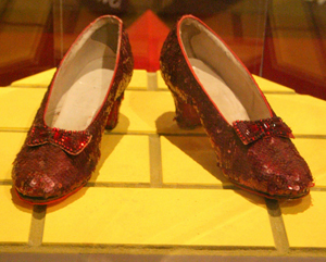 An original pair of ruby slippers worn by Judy Garland in her lead role as Dorothy Gale in the film classic 'The Wizard of Oz,' displayed at the American History Museum, The Smithsonian Institution. Image courtesy of RadioFan at en.wikipedia.