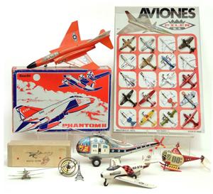 Aviation toys from the GR Webster collection, including a Sanchis Phantom II boxed jet and a Pilen S.A. store display with 20 miniature metal planes. Stephenson's image.