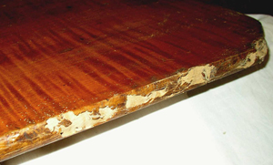 The Damage To This 18th Century New England Tiger Maple Tilt Top Was Done By
