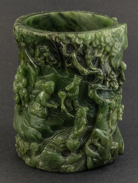 Green jade carved brush holder. Four Seasons Auctioneers image.