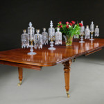 An early 19th century mahogany extending dining table from W R Harvey & Co (Antiques Ltd)