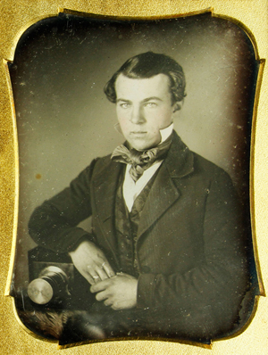 Daguerreotype, one-fourth plate, of a young photographer sitting beside his camera, full leather case, 4 1/2 inches high. Price realized: $17,550. Kaminski Auctions image.