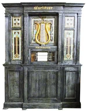 Wurlitzer Style 17 PianOrchestra, 94 inches tall, in a handsome display cabinet. Price realized: $120,000. Showtime Auction Services image.