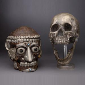 Two white metal mounted human skulls, est. $1,000-$1,500. Michaan's image.