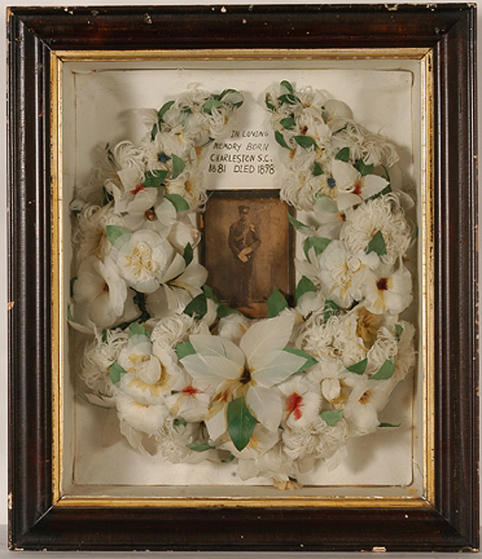 Unknown African American, 'In Loving Memory' memorial wreath, chicken feathers, paint and photo. Estimate: $1,000-$2,000. Slotin Auction image.