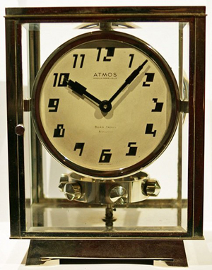 Very rare French Atmos Pendule Perpetull clock, silver dial with Art Deco Arabic markers, patent plaque inscribed 'BREVETS J.L. REUTTER, S.G.D.G., MADE IN FRANCE. Est. $8,500-$10,000. Image courtesy of Baer & Bosch Auctioneers.