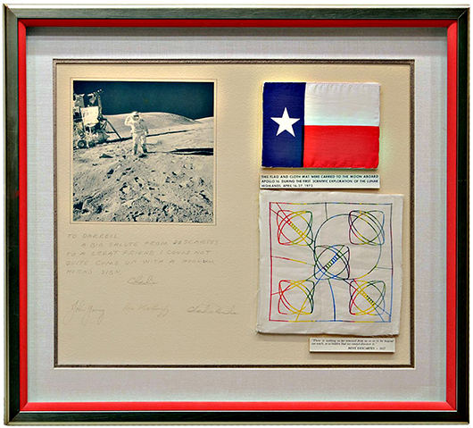Framed Texas flag and football embroidery carried to the moon aboard U.S. space mission, Apollo 16 signed by the astronauts. Austin Auction Gallery image.