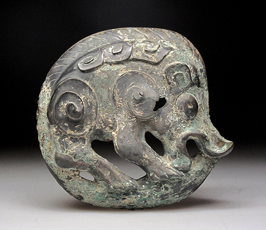 Chinese bronze curved shaped boar decoration, Western Zhou period, 10.6 centimeters wide. Joyce Gallery Auction image.