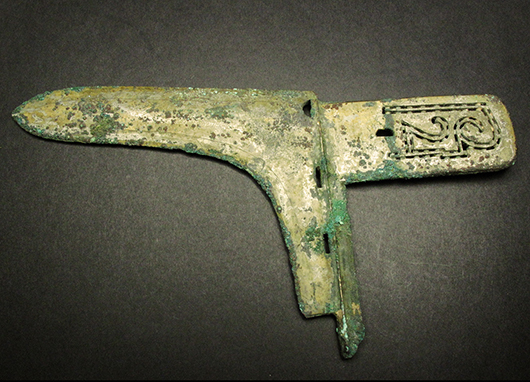 Chinese bronze dagger ax, Spring and Autumn period, 21.5 centimeters wide. Joyce Gallery Auction image.