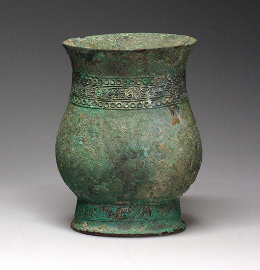 Chinese bronze wine vessel, Zhi, late Shang period,12 centimeters high by 9.1 centimeters wide. Joyce Gallery Auction image.
