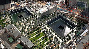 Photo of the World Trade Center 9/11 Memorial as it appeared in June 2012. Photo taken from the World Financial Center by Cadiomals, licensed under the Creative Commons Attribution-Share Alike 3.0 Unported license.