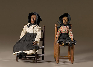 Kentucky folk art dolls, early 20th century, carved pine with articulated limbs, dressed in hand-sewn clothing and seated on ladderback chairs. Image courtesy of LiveAuctioneers.com Archive and Cowan's Auctions.