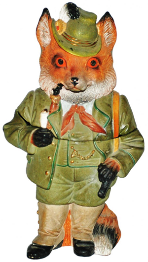 This well-dressed fox is a tobacco jar, not a figurine or a cookie jar. He is dressed to go hunting. The terracotta jar is marked by Jon (Johan) Maresh, who used the mark