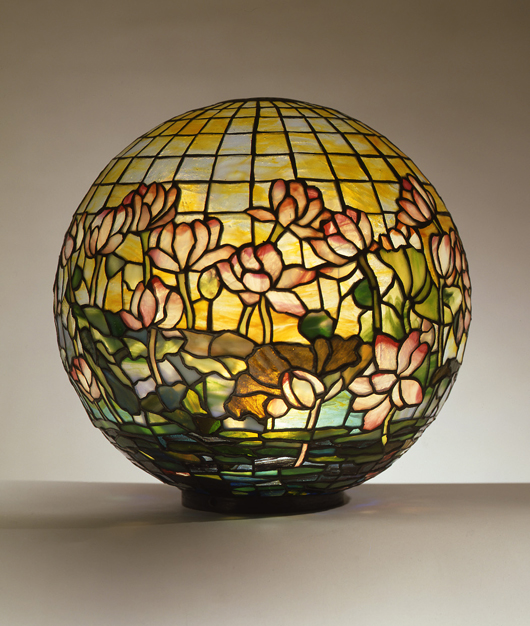 Tiffany glass, both lighting and windows, was often destined for a special setting in a sumptuous interior. This rare Neustadt Collection globe shade with lilies rising from water once graced the newel post of a grand staircase. Courtesy Neustadt Collection of Tiffany Glass