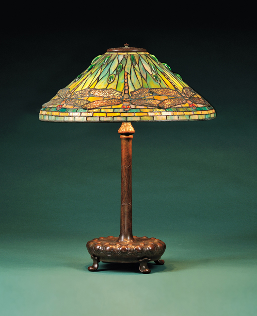 Although floral themes dominate lamp repertoire, collectors clamor for designs with fluttering creatures from the insect world. This lamp with a dragonfly shade signed Tiffany Studios New York sold for $74,063 at Skinner's last December. Courtesy Skinner Inc.