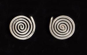 Alexander Calder sterling silver spiral earrings. Woodbury Auction image.