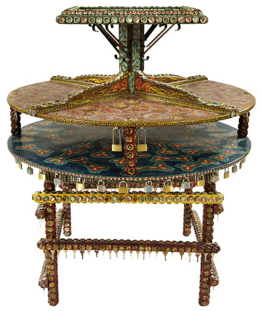 Jon Bok 20th century center table, top tier having a ceramic tile insert of skull and crossbones. Crescent City Auction Gallery image.