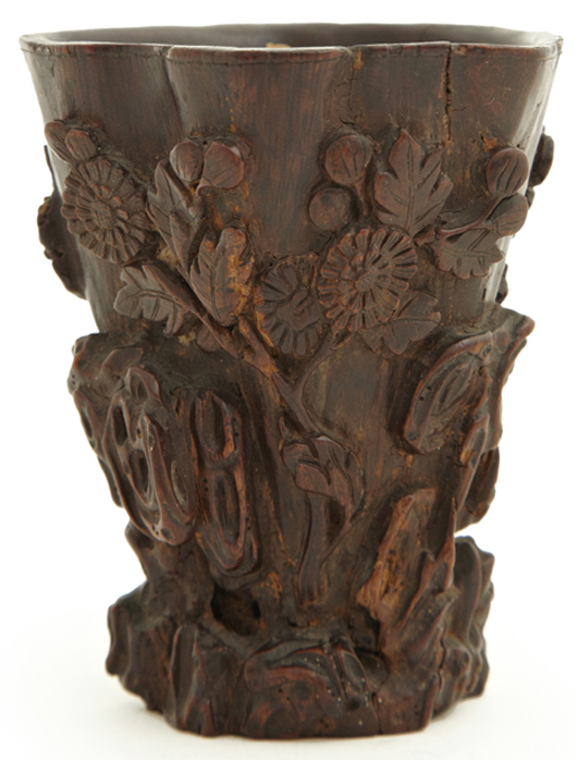 Highly collectible Chinese carved rhinoceros horn libation cup, one of three such cups to be sold. Crescent City Auction Gallery image.