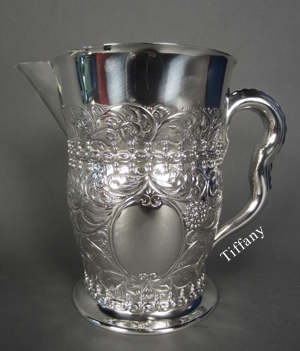 Beautiful and unique repousse-decorated Tiffany & Co. sterling silver 5-pint pitcher, circa 1891-1902. Possibly a custom-made piece. Height: 8 1/4 inches. Width: 9 1/2 inches. Sterling Associates image.