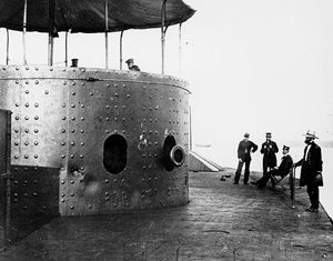 View on deck of the USS Monitor looking forward on the starboard side, while the ship was in the James River, Va., July 9,1862. The turret, with the muzzle of one of the ironclad's two XI-inch Dahlgren smoothbore guns showing, is at left. Image courtesy Wikimedia Commons.